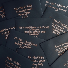 ENVELOPES / copper lettering on black