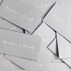 TALLOW + HUSK / branding in white foil on grey