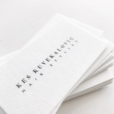 KES KUVEKALOVIC / branding in gun metal grey foil on white