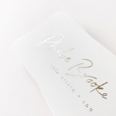 PHOBE BROOKE / branding in pale gold on white
