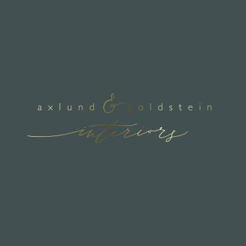 AXLUND & GOLDSTEIN INTERIORS BRANDING / gold on charcoal grey