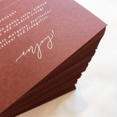 ASHLEE & HANIF / white ink on burgundy menus