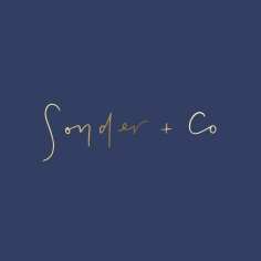 SONDER + CO / branding in gold foil on navy