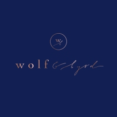 WOLF & BYRD / branding in rose gold foil on navy