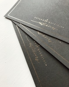 AXLUND & GOLDSTEIN INTERIORS BRANDING / gold on charcoal grey
