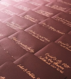 SOPHIE & JARROD / gold hand lettering on burgundy envelopes