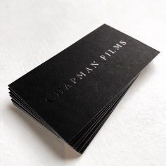 CHAPMAN FILMS / branding in black foil on black