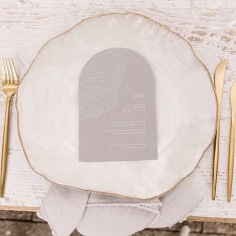 ELLIE & DOM / white ink on grey arch menus. Styling / @heart_strings_hire_n_style Photo / @sarahtonkinphotography Cutlery / sideserveperth