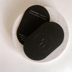 CALAUTTI DESIGN / branding in blind emboss and white ink on black