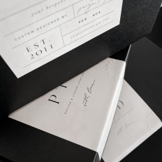 PAIGE TUZEE / packaging labels featuring black print and blind emboss